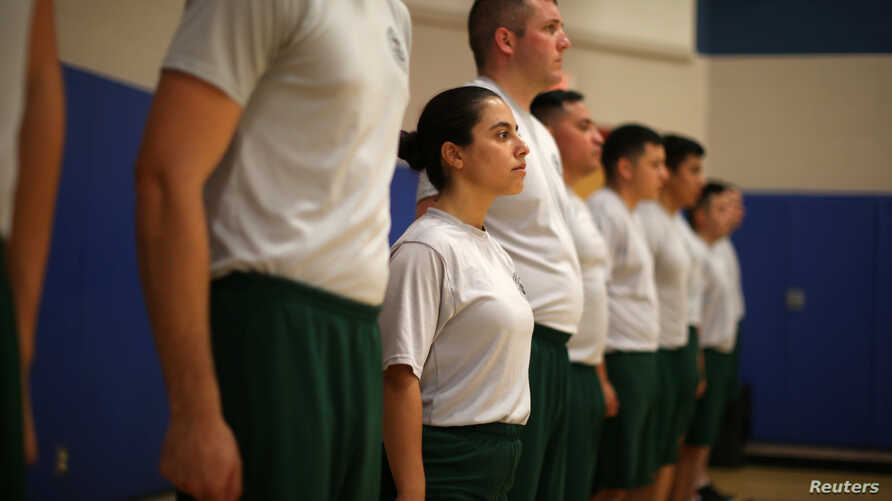 Border patrol trainee Stevany Shakare, second from left, takes part in a physical training class at the United States Border Patrol Academy in Artesia, New Mexico, June 8, 2017.