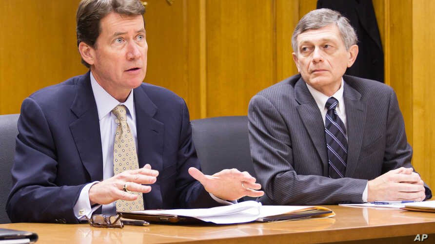 FILE - Bill Hagerty, former Tennessee Economic and Community Development Commissioner, (left) and fiscal policy adviser Paul VanderMeer appear before a state commission, Feb.5, 2014.