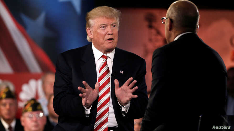 Republican presidential nominee Donald Trump speaks to Matt Lauer during the Commander in Chief Forum in Manhattan, New York, Sept. 7, 2016.