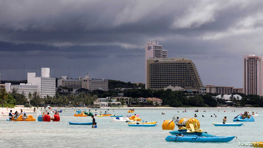 Tourists frolic on the waters overlooking posh hotels in Tumon tourist district on the island of Guam, a U.S. Pacific Territory, Aug. 10, 2017.