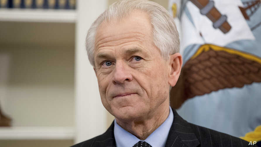 National Trade Council adviser Peter Navarro waits on President Donald Trump in the Oval Office at the White House, March 31, 2017, in Washington.