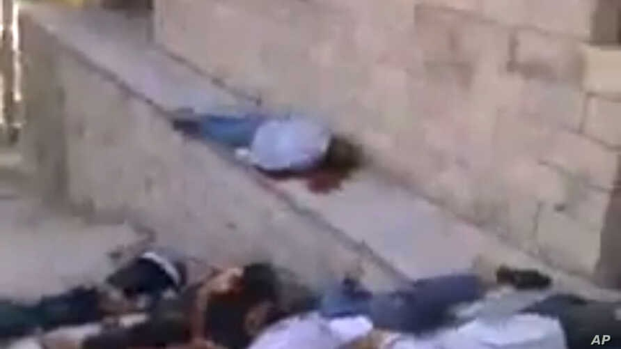 In this image taken from amateur video, which has been authenticated based on its contents and other AP reporting, dead bodies are seen in Bayda, Syria, Friday, May 3, 2013. Syria's main opposition group on Friday accused President Bashar Assad's reg