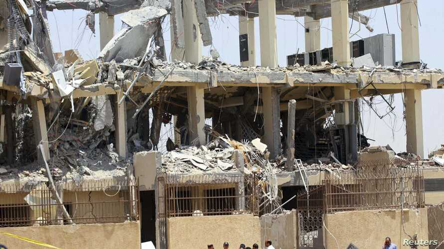 Damage is seen at the site where two bombs exploded on Cairo's outskirts, June 28, 2014.