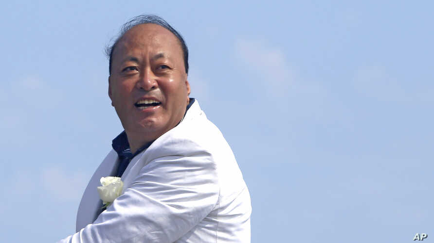 FILE -- Billionaire Li Jinyuan is CEO of China's Tiens Group, spans e-commerce, hotel and tourism and biotech industries.
