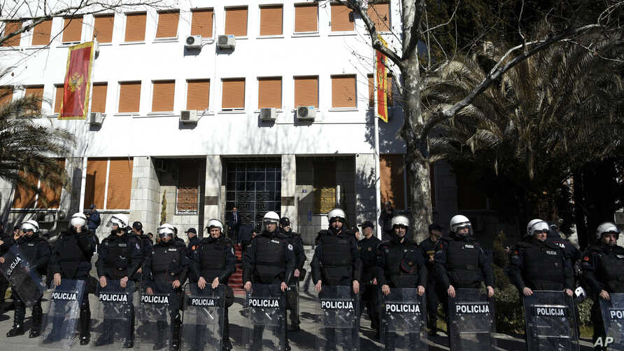 Montenegro riot police guard the Parliament building during an anti-government protest in Podgorica, Montenegro, Feb. 15, 2017.