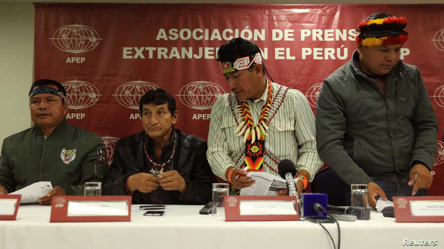 Chiefs of Amazonian tribes, Emerson Sandi, Alfonso Lopez, Aurelio Chino and Carlos Sandi attend a news conference with the foreign media in Lima, Aug. 22, 2017.