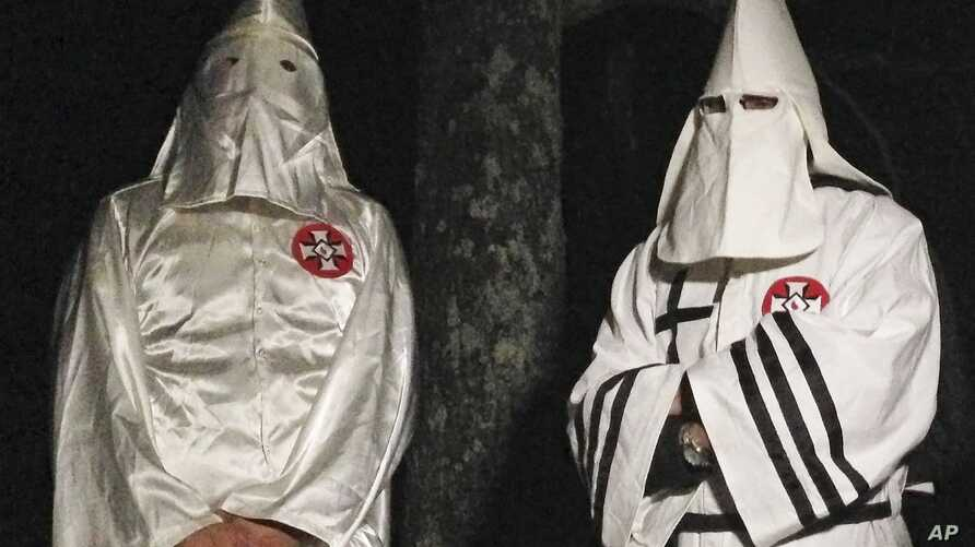 Two Ku Klux Klansmen take part in an interview near Pelham, North Carolina, Dec. 2, 2016. Glendon Crawford, sentenced to 30 years in prison, Dec. 19, 2016,  for trying to build a bomb, was a self-professed member of the KKK.