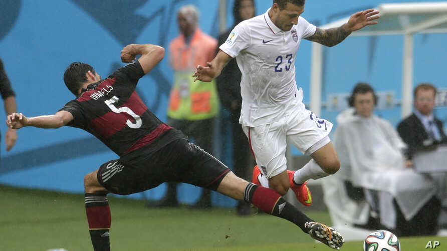 Germany's Mats Hummels, left, and United States' Fabian Johnson challenge for the ball during the group G World Cup soccer match between the USA and Germany at the Arena Pernambuco in Recife, Brazil,  June 26, 2014.