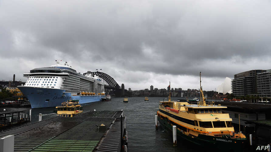 Heavy clouds cover Sydney Harbor on Nov. 28, 2018.  Flights were cancelled, railway lines closed and motorists stranded on flooded roads as a month's worth of rain fell on Sydney.