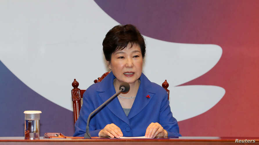 South Korean President Park Geun-hye speaks during an emergency cabinet meeting at the Presidential Blue House in Seoul, South Korea, Dec. 9, 2016.