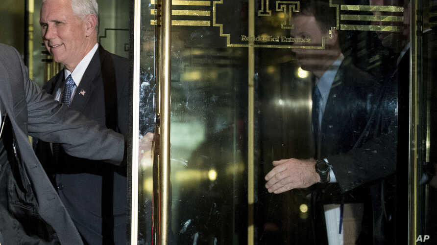 Vice President-elect Mike Pence leaves Trump Tower, Dec. 5, 2016.