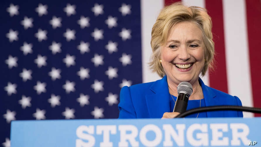 FILE - Democratic presidential candidate Hillary Clinton pauses while speaking at a rally at Johnson C. Smith University, in Charlotte, N.C., Sept. 8, 2016.