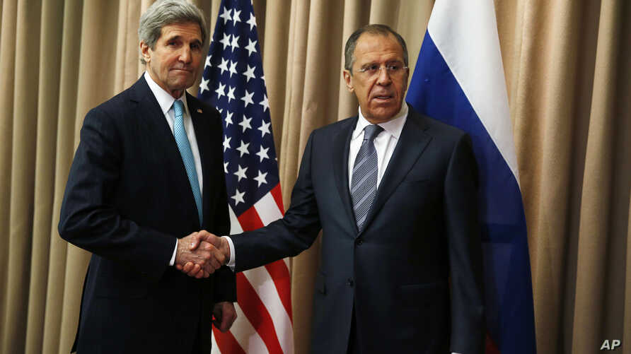 U.S. Secretary of State John Kerry, left,  shakes hands with Russian Foreign Minister Sergey Lavrov at a bilateral meeting to discuss the ongoing situation in Ukraine as diplomats from the U.S., Ukraine, Russia and the European Union gather for discu