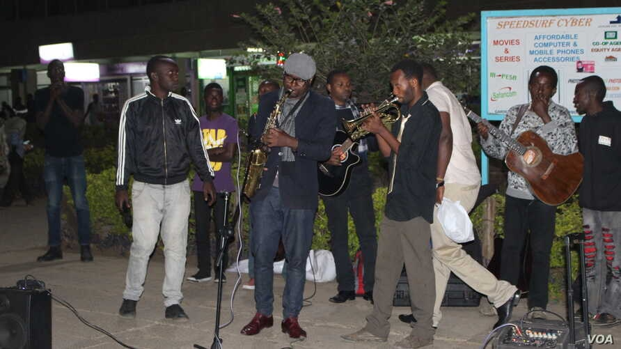 Moses Odhiambo plays with a group of street performers on a Thursday evening, April 27, 2017. He is a self-taught saxophonist and has been drawing crowds and inspiring a love of music in young people who like himself are grew up on the streets. (Phot