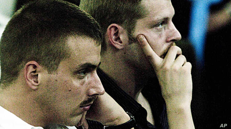 FILE - Norwegian citizens Tjostolv Moland (l) and Joshua French during their trial in Kisangani, Congo, Dec. 3, 2009.