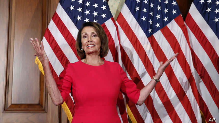 House Speaker Nancy Pelosi of Calif., gestures before a ceremonial swearing-in on Capitol Hill in Washington, during the opening session of the 116th Congress,  Jan. 3, 2019.