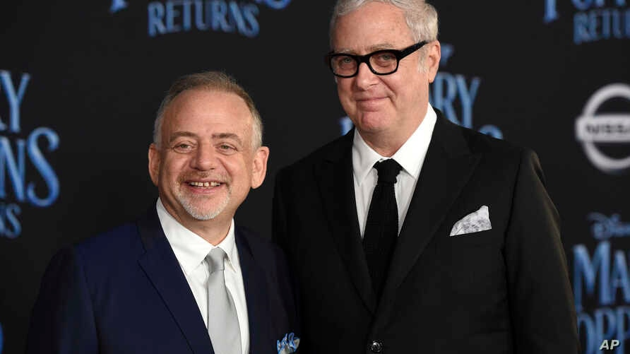 """FILE - Marc Shaiman, left, and Scott Wittman, co-lyricists for the songs in """"Mary Poppins Returns,"""" pose at the premiere of the film in Los Angeles, Nov. 29, 2018."""