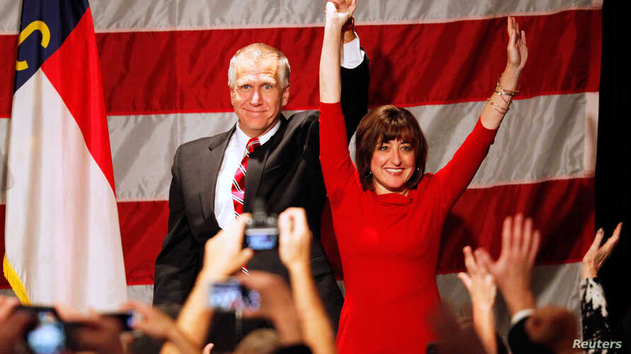 Republican Thom Tillis (L), and wife Susan react after the results of the U.S. midterm elections early morning in Charlotte, North Carolina, November 5, 2014.