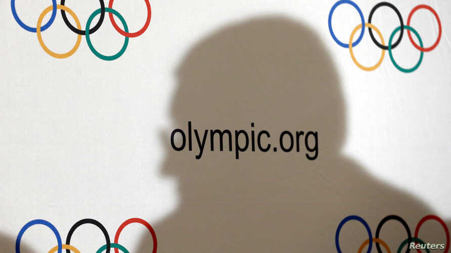 FILE - International Olympic Committee (IOC) President Thomas Bach casts a shadow during a news conference after an Executive Board meeting in Lausanne, Switzerland, Dec. 8, 2016.