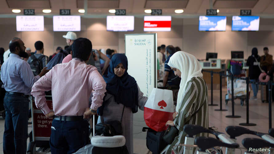 People line up to check in for a flight from Toronto Pearson International Airport to Riyadh, Saudi Arabia, in Toronto, Canada, Aug. 10, 2018.