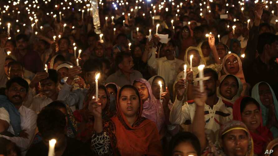 Pakistani Christians hold candles during a vigil for victims of a deadly suicide bombing last Sunday, in Lahore, Pakistan, Wednesday, March 30, 2016.