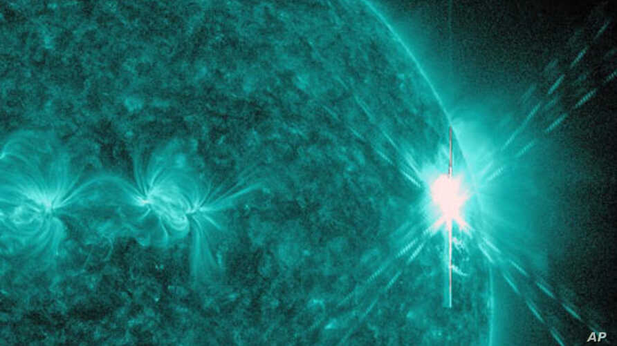 This image provided by NASA shows a solar flare, the largest in 5 years. The image was was captured by NASA's Solar Dynamics Observatory (SDO) in extreme ultraviolet light at 131 Angstroms.  Scientists say the bursts of radiation hurled by the solar
