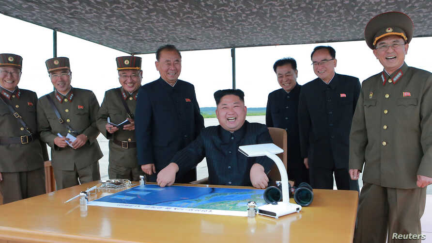 North Korean leader Kim Jong Un inspects a long and medium-range ballistic rocket launch drill in this undated photo released by North Korea's Korean Central News Agency in Pyongyang on Aug. 30, 2017.