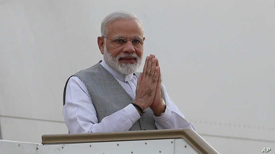 Indian Prime Minister Narendra Modi greets as he disembarks from the aircraft upon his arrival in Colombo, Sri Lanka, Thursday, May 11, 2017.