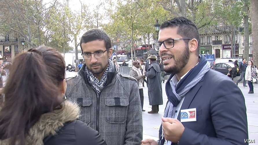 Nizarr Bourchada, a member of France's Union of French Muslim Democrats, showed up Monday at the Place de la Republique to pay tribute to the 129 people killed in last week's Paris attacks, Paris, Nov. 16, 2015.