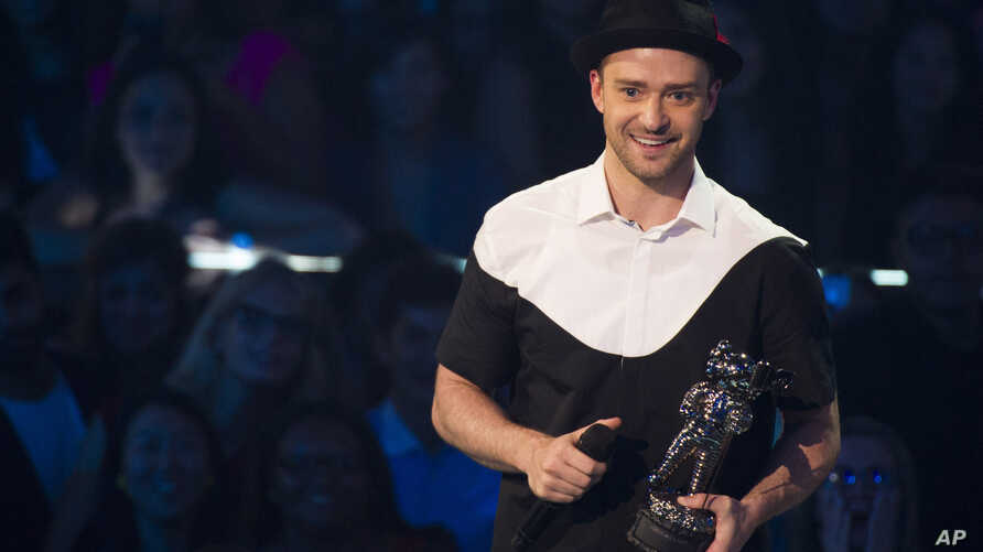 """Justin Timberlake accepts video of the year award for """"Mirrors"""" at the MTV Video Music Awards Aug. 25, 2013, at the Barclays Center in the Brooklyn borough of New York."""