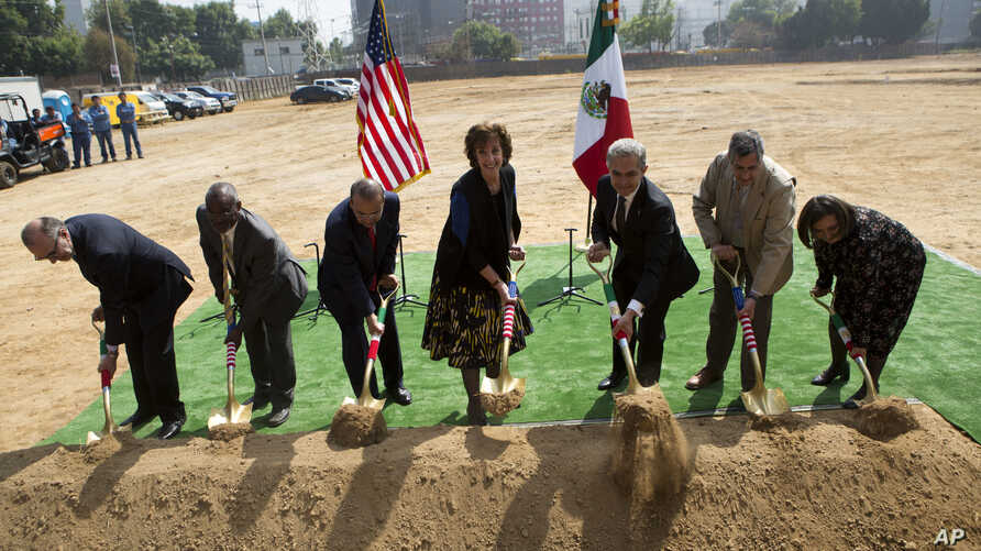 U.S. Ambassador to Mexico Roberta Jacobson, center, is accompanied by Mexico City Mayor Miguel Angel Mancera, center right, Secretary of the Interior Alfonso Navarrete Prida, center left, and other Mexican and U.S. officials during the groundbreaking