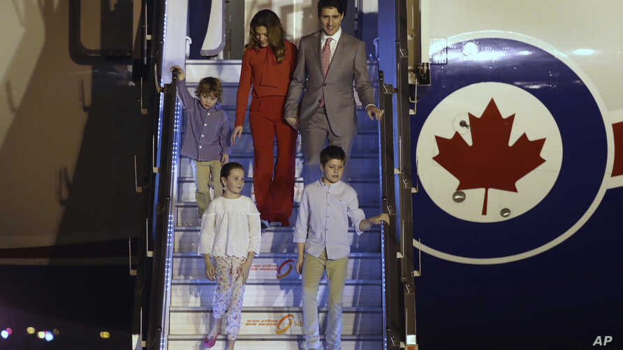 Prime Minister Justin Trudeau, his wife, Sophie Gregoire Trudeau, their sons Hadrien and Xavier, daughter Ella-Grace walk down an airstair upon their arrival at the Palam Air Force Station in New Delhi, India, Feb. 17, 2018.