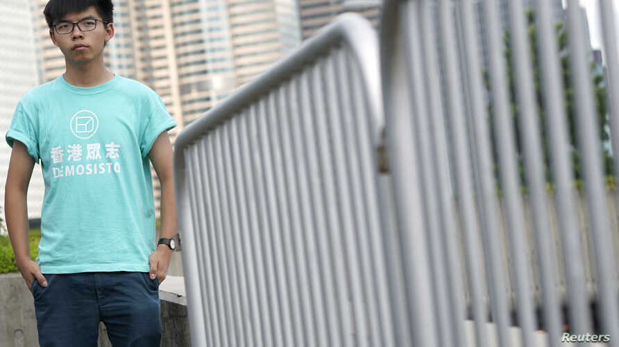 """Hong Kong student leader Joshua Wong poses for a photo, a day before an appeal verdict on charges relating to 2014 pro-democracy """"Umbrella Movement,"""" also known as """"Occupy Central"""" protests, in Hong Kong,  Aug. 15, 2017."""