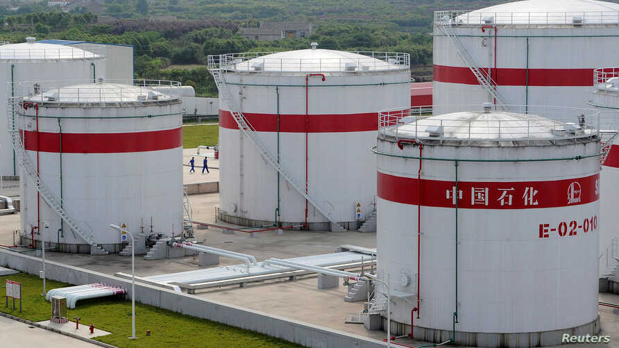 FILE - Oil tanks at a Sinopec plant in Hefei, Anhui province, May 31, 2009. China has announced that it will limit supplies of refined petroleum products to North Korea.