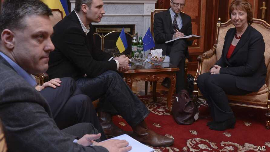 Ukrainian opposition leader Oleg Tjagnibok, left, and Ukrainian lawmaker and chairman of the Ukrainian opposition party Udar (Punch), former WBC heavyweight boxing champion Vitali Klitschko, second left, during their talks with EU foreign policy chie