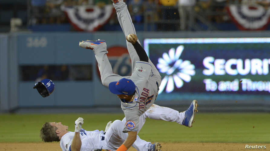 FILE - New York Mets shortstop Ruben Tejada (11) suffered a broken leg on this play when Los Angeles Dodgers second baseman Chase Utley (26) rolled toward him to try to break up a double play in a National League Division Series game at Dodger Stadiu