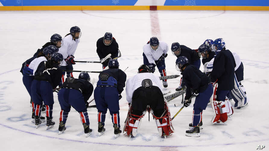 The joint Korean women's ice hockey players gather on the ice during a training session prior to the 2018 Winter Olympics in Gangneung, South Korea, Monday, Feb. 5, 2018.