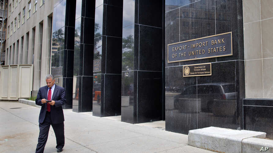 FILE - A man walks out of the Export-Import Bank of the U.S. in Washington.