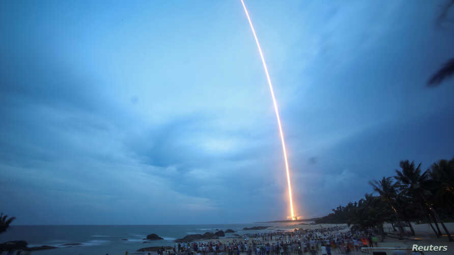People watch the launch of the Long March-5 Y2 rocket from Wenchang Satellite Launch Center in Wenchang, Hainan Province, China, July 2, 2017.