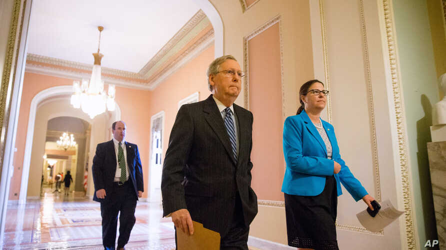Senate Majority Leader Mitch McConnell walks from his office to the Senate floor on Capitol Hill in Washington, April 23, 2015.