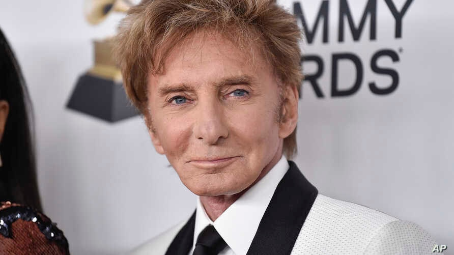 Barry Manilow arrives at 2018 Pre-Grammy Gala And Salute To Industry Icons at the Sheraton New York Times Square Hotel, Jan. 27, 2018, in New York.