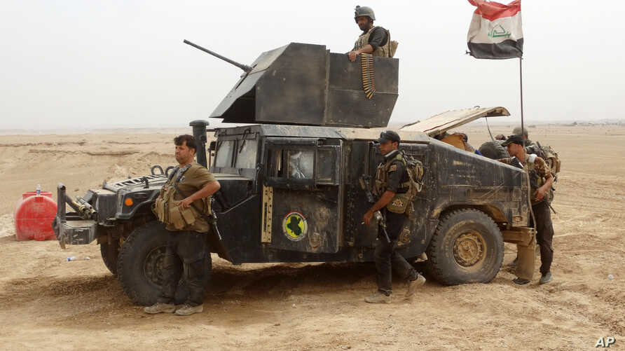 Military reinforcements for Iraqi anti-terrorism forces arrive at the Ramadi Stadium after regaining control of the complex and the neighboring al-Bugleeb area, Oct. 6, 2015.