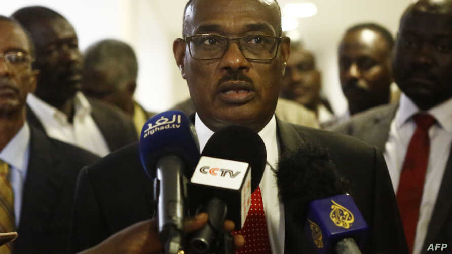FILE - Sudanese Foreign Minister Al-Dierdiry Ahmed talks to the press in the Sudanese capital Khartoum, Aug. 28, 2018.