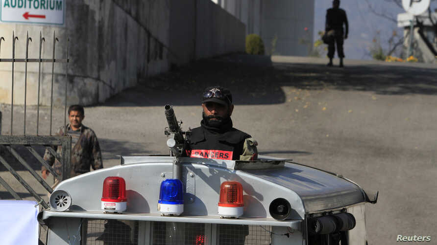 FILE - A paramilitary soldier stands guard outside a court building in Islamabad, Pakistan, Jan. 2, 2014.