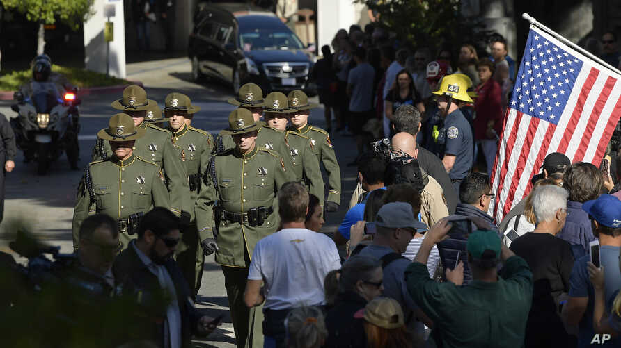 The body of Ventura County Sheriff's Department Sgt. Ron Helus is transported from the Los Robles Regional Medical Center, Nov. 8, 2018, in Thousand Oaks, Calif., after a gunman opened fire Wednesday inside a country music bar killing multiple people