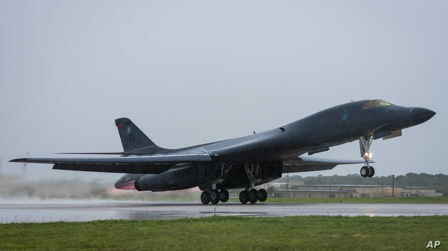 In this photo released by the U.S. Air Force, a U.S. Air Force B-1B Lancer bomber assigned to 37th Expeditionary Bomb Squadron, deployed from Ellsworth Air Force Base, South Dakota, takes off from Andersen Air Force Base, Guam, Sept. 9, 2017.