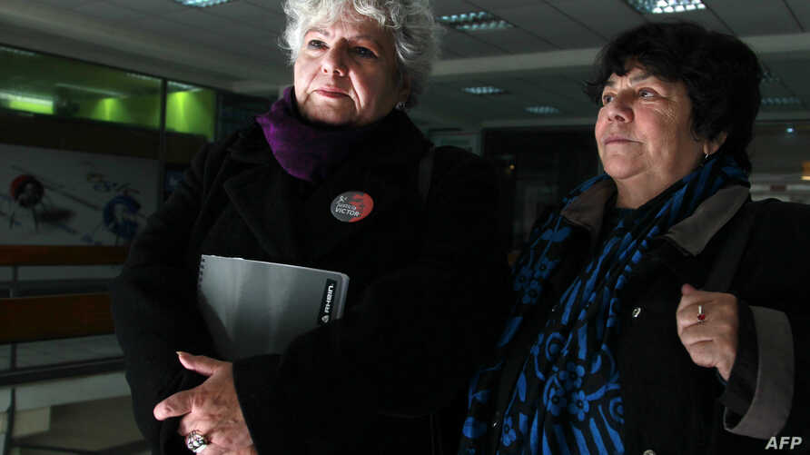Veronica de Negri (L), mother of photographer Rodrigo Rojas de Negri, killed during the Pinochet dictatorship and Alicia Lira, president of the Association of Relatives of Political Prisoners Executed leave a court in Santiago, Chile, July 24, 2015.
