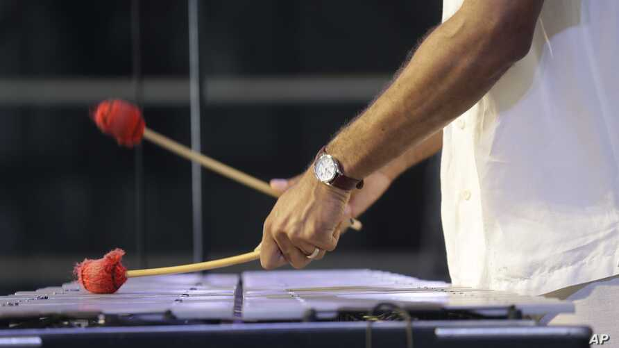 FILE - A jazz musician plays the vibraphone.