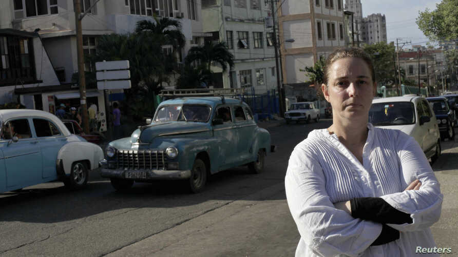 Cuban artist Tania Bruguera posses for a picture in Havana, Dec. 31, 2014.