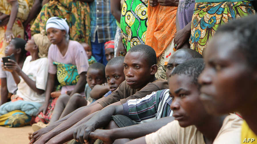 A group of Burundian refugees waits for a soap and blanket distribution at Gashora on Bugesera, Rwanda, April 10, 2015.
